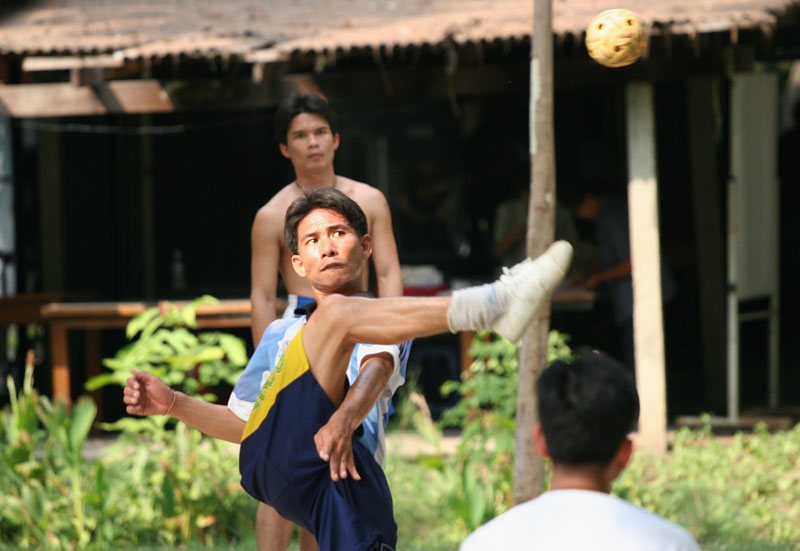The curious sport of Ta-Graw, a sort of soccer like volleyball sport which is very popular in South East Asia.