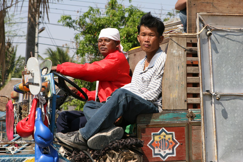 I'd just come out of a restaurant in rural Korat when these two guys go trundling by in one of those strange Isaan style trucks. Amazing I got this on in focus.