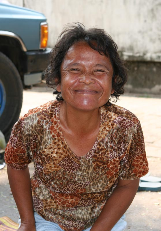 This woman's family were selling pomello out of the back of the family pick up truck in central Mahasarakham. She told me she wanted to be naughty with me. When I laughed and turned her down she offered me her 17 year old daughter. Hard to believe, but I assure you, 100% true!