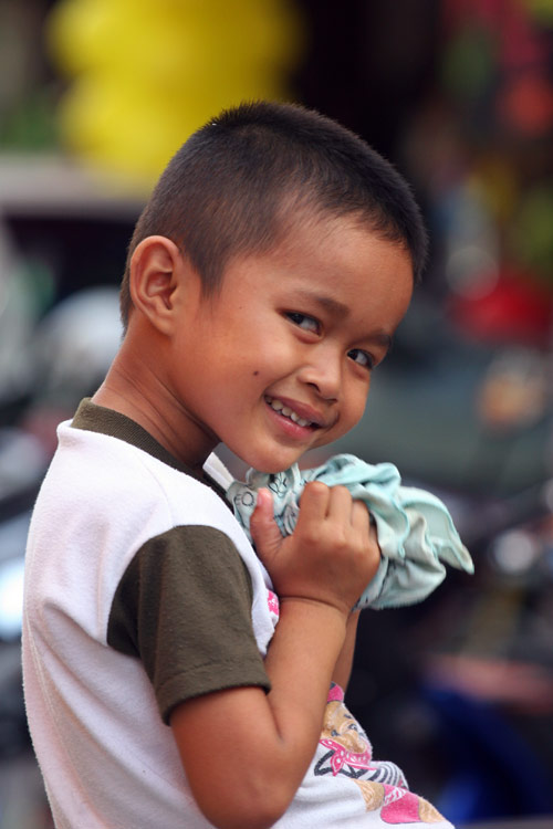 A young lad grins away - probably because he was enjoing the sights on Soi Pattayaland 2!