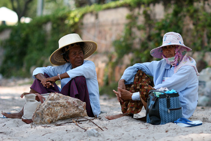 These two old ducks massage tourists on the beach at Hua Hin.
