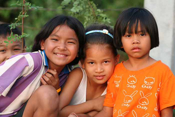 Cute kids in rural Thailand. Once they saw the camera and saw the immediate results, they were begging me to take more shots. I went through a whole gigabyte memory card in less than 30 minutes!