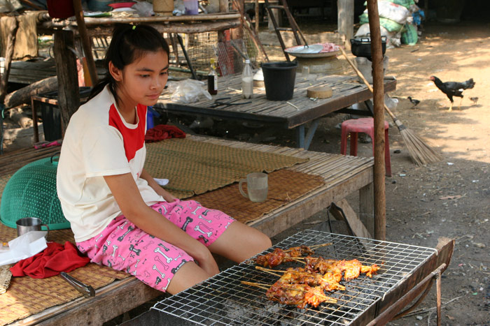 Her job is to grill chicken and sell it out the front of her house. I doubt she would make much more than 50 baht a day profit.... It's a hard life!
