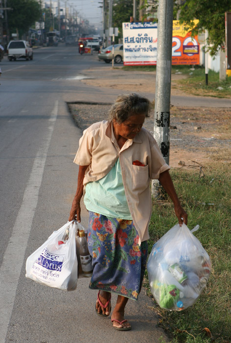 This photo was taken outside the beautiful 9-storey temple in Khon Kaen. This poor old lady was not carrying the shopping, but looked to be a scavenger, collecting rubbish and taking it to one of the recycling plants where she would get a few baht for the lot.