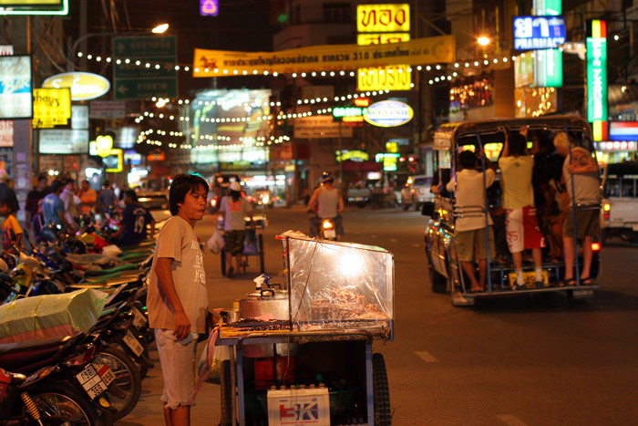 A vendor sells insects and other tasty snacks on Second Road, Pattaya.