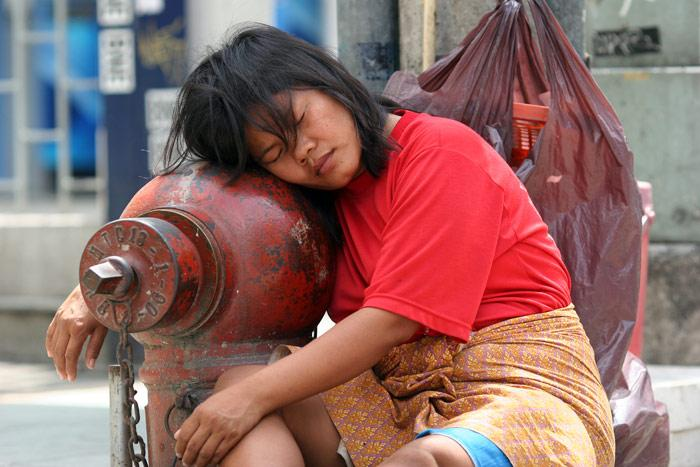I guess she was a homeless girl who chose to sleep with the fire hydrant as her pillow, on Khao San Road.