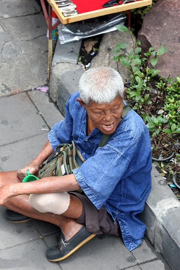 This beggar looks as though he suffered from leprosy and is a common sight begging on Sukhumvit. It is rumoured that many of these beggars are part of controlled gangs and little of the money they receive is for them.