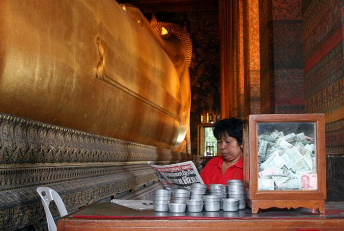 The view of the world's largest gpld reclining Buddha lost its allure for her a long time ago...