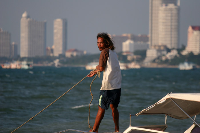You go island, mister? The seaman is about to drift off in the late afternoon Pattaya afternoon sun.