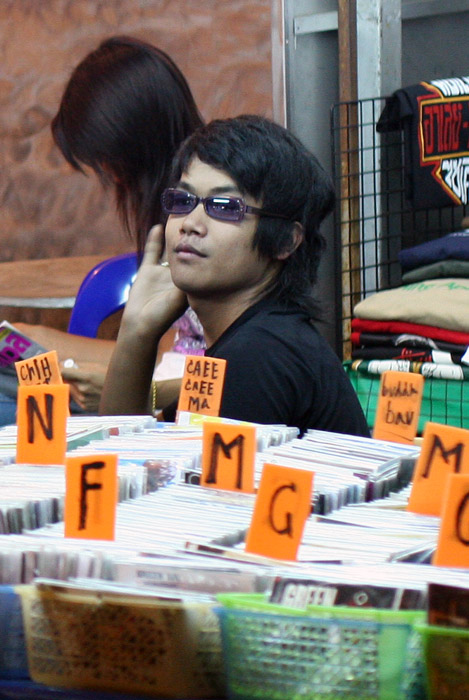 Is he trying to look like Elvis? A vendor on Khao Sarn Road has a selection of the latest albums at a mere 100 baht a copy, copy being the most apporpriate word!