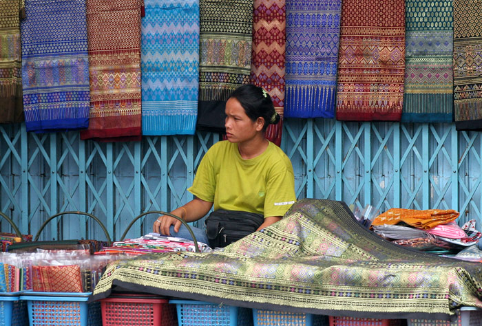 A silk vendor in Korat, the city with two names. It is also known as Nakhon Rachasima.