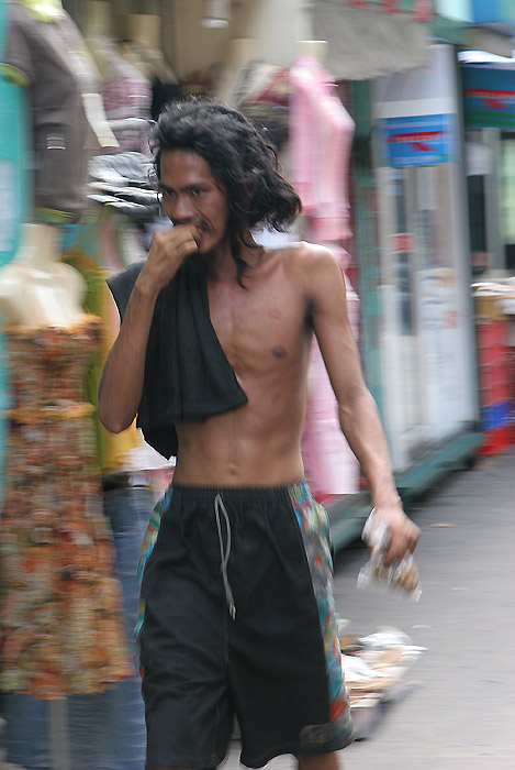 His name is Oat. He is a homeless fellow who is often seen around the Silom Road area, particually in Soi Thaniya where this photo was taken.