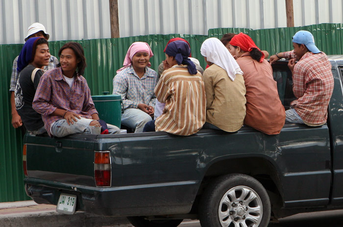 Labourers at the end of the day. It is not unusual to see gangs of Thais sitting casually in the back of a pick up truck as it barrels along intercity roads at high speed.