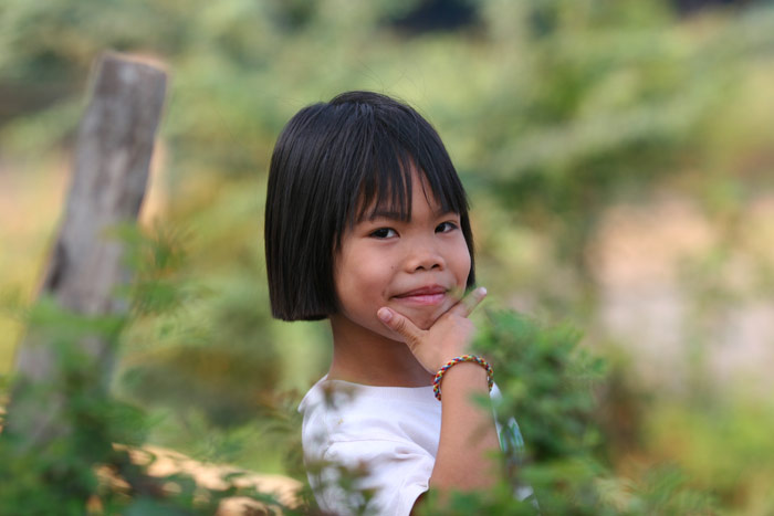 A cute kid in rural Udon Thani. She just jumped up and posed and I fired off the shot with no time to compose, so was well pleased with how it turned out.