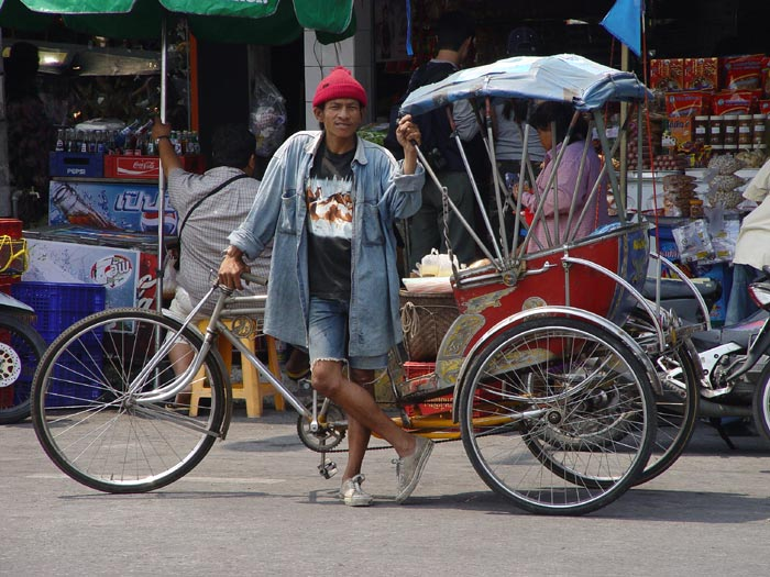 A samlor rider in central Korat. The locals might use them a lot but I prefer tuktuks. Samlors are slow. Did you know what samlor means three wheels? sam = three lor = wheel