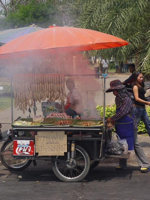 A street vendor selling some weird Isaan style sausages in the centre of Korat. I love taking photographs in this area because there is always something happening.