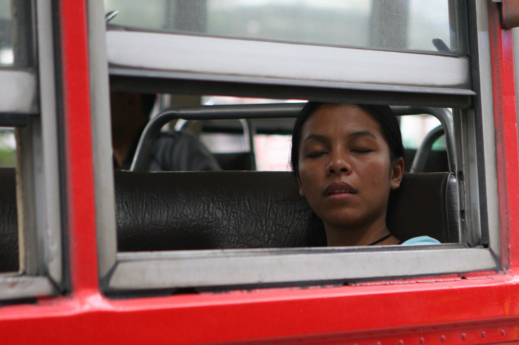 Time to take a nap....the most popular way for passengers to deal with the city's awful traffic jams. Most folks who manage to get a seat on a Bangkok bus do their best to have a snooze.