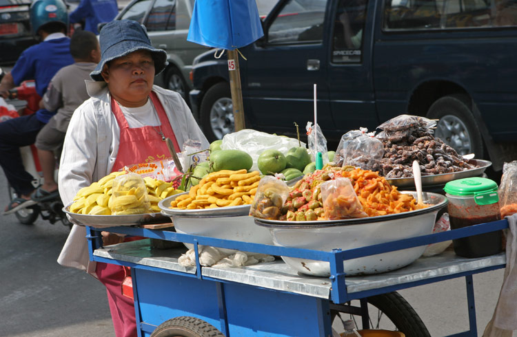 Don't ask me what that is she is selling! After 7+ years in country, the goodies that some vendors peddle still puzzle me. Mystery fruit and mystery vegetables!! The only identifiable thing is mango.