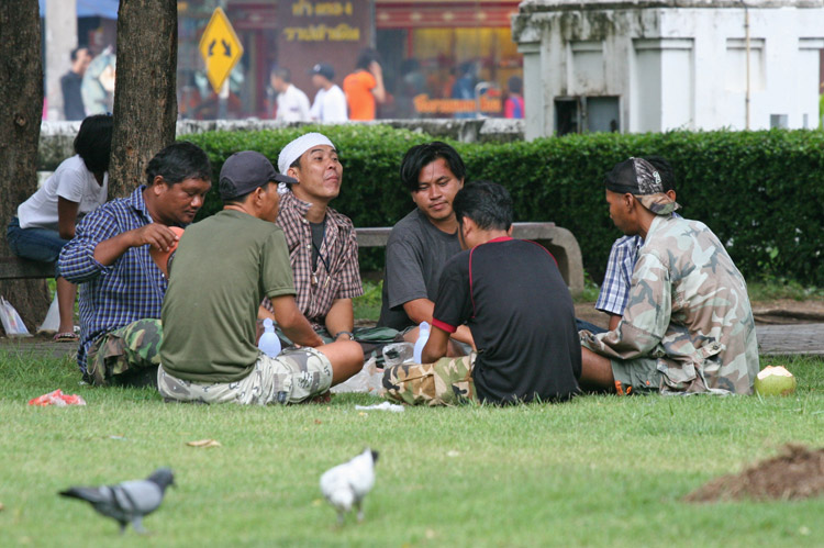 And in another part of the very same park, a bunch of Thai men sit around, chat and enjoy the fresh air.