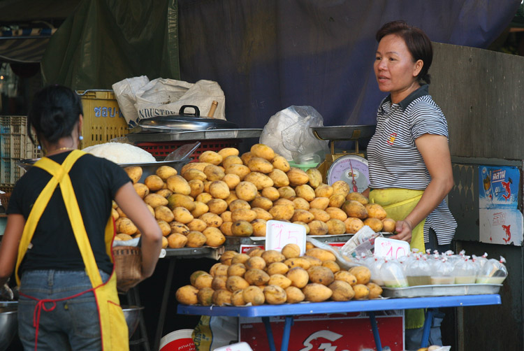 A mango vendor sells some motley looking produce on South Pattaya Road.