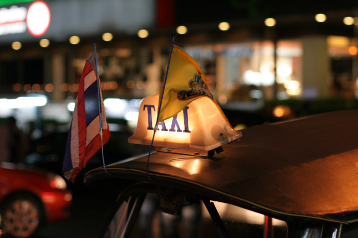A tuktuk decorated with HM The King's emblem on a flag at the time of the anniversary of HM's 60th anniversary as King of the country.