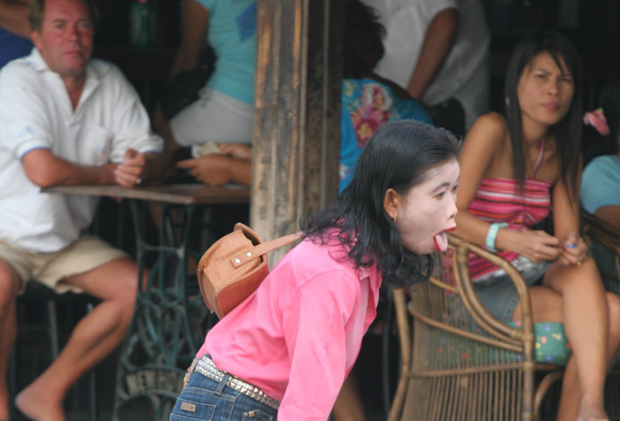 This was one scary, creepy woman. I kept seeing her around Pattaya and she would be constantly be yelling and screaming at no-one on particular. The folks in the background look bemused.